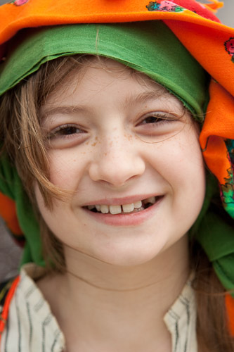 Young girl in colorful traditional Greek headscarf.