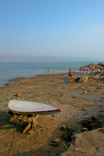 Photo of the beach at the Dead Sea, with a shallow skiff.