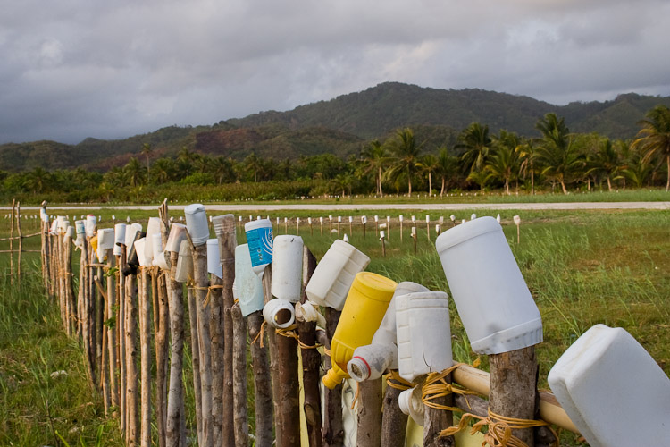 Photo of a small regional airport with plastic bottles for runway markers.